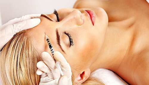 female under botox injection in New Jersey
